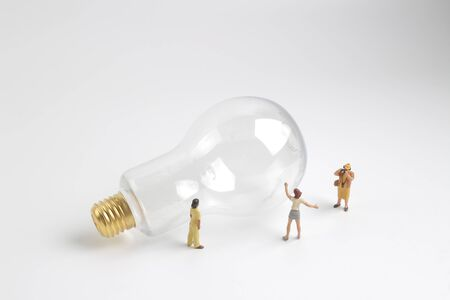 the group of figure working on a  bulb