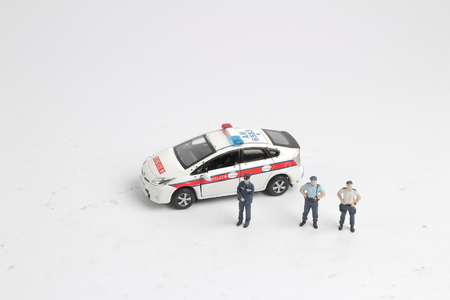 the figure of a police men and police car