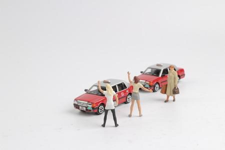 ホワイトボードでフィギュアとhkタクシー 写真素材