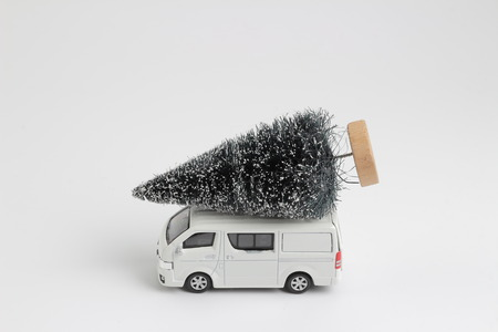 the transport van with christmas tree on white Stock Photo