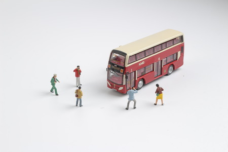 the group of figure taking photo with bus Stock Photo