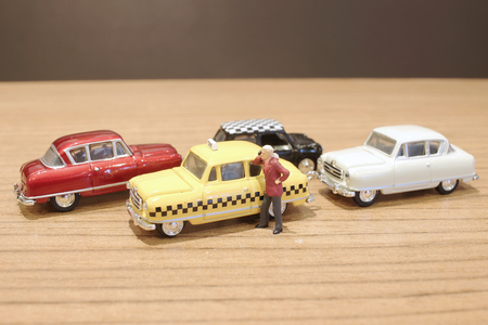 a  small figure and toy car and bike 版權商用圖片
