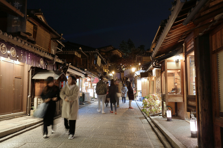 Bustling pedestrian street on a hill lined at night
