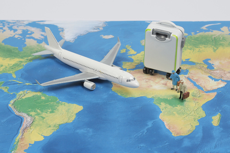 a Mini traveler with airplane, travel and business concept. Stock Photo