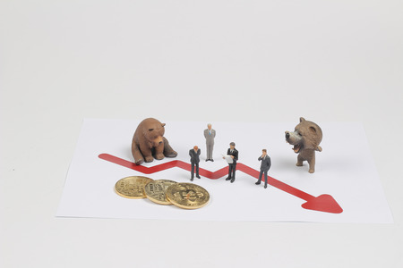 a fun figure with business man and bear Stock Photo