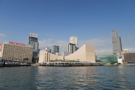 Victoria Harbor in the day with blue sky, boat and cloud.