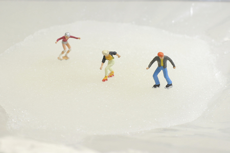 a fun of Tiny toy skaters on ice