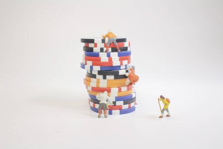 the mini figure climb on poker chips isolated