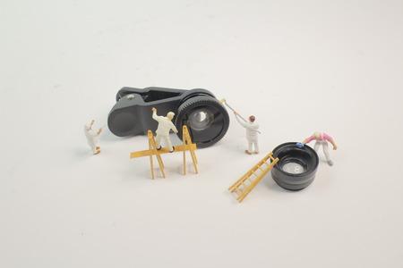the mini woker clearing the mini lens Stock Photo