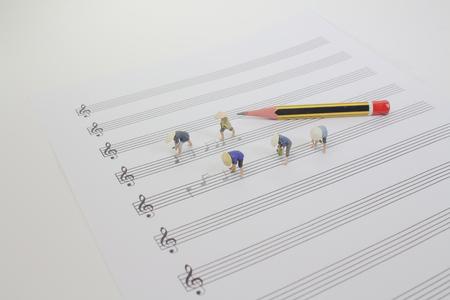 the tiny farmer working on the music sheet Standard-Bild