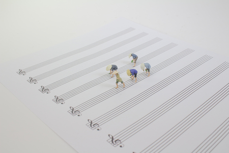 the tiny farmer working on the music sheet Stock Photo