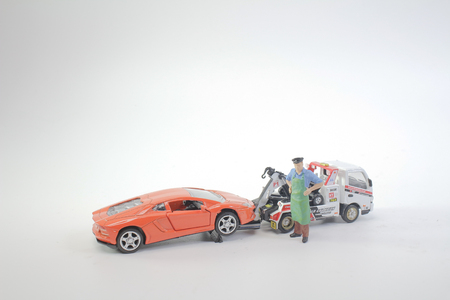a worker figure with the tow truck Editorial