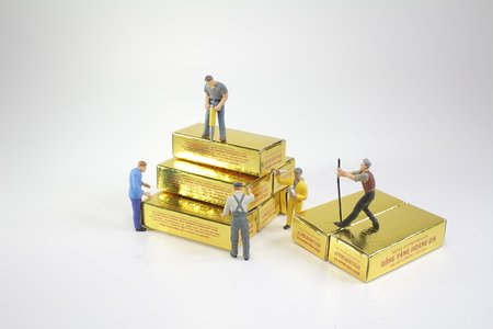 the worker figure moving of the gold,