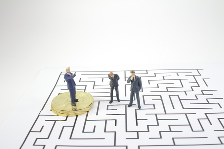 a Business man standing on of maze