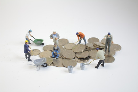 mini workers move coins. Growing a money
