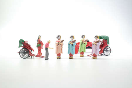 statue and red vintage oriental rickshaw cab