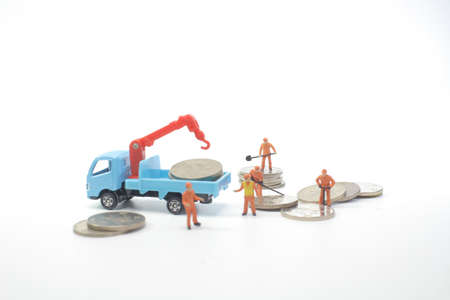 Road works with mini workers in a country