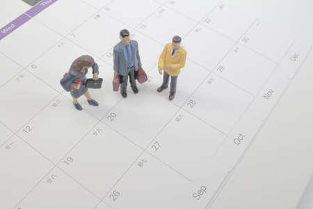 mini Business man figure on the calendar