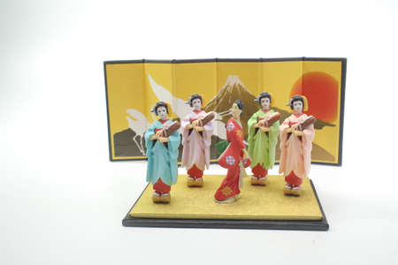 a Japanese figurine with white back ground Stock Photo