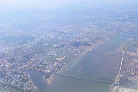 Aerial view of plane window looking down to land 版權商用圖片