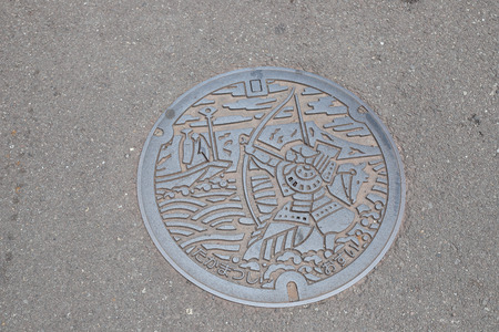 the city of icon on thecover of Manhole