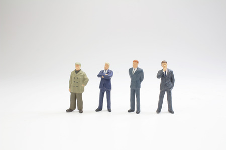 Figures business men stand on white Back ground 版權商用圖片