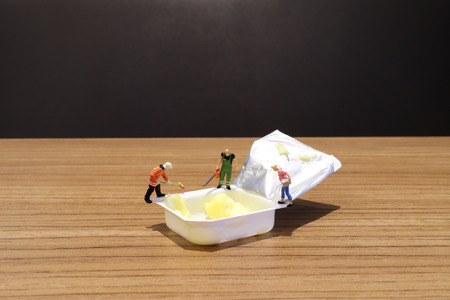 a  mini figure are working with butter