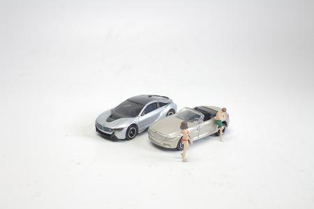 mini figure bikini girl posing near car 写真素材