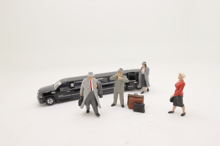 the figures are  standing with blurred car