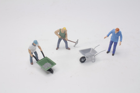 a figure worker toy cement mixing manually Stock Photo