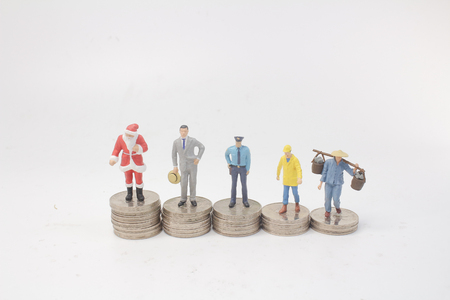 a mini people are standing on piles
