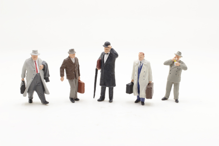 a small figures of  business men stand Stock Photo