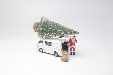 the Santa Claus is driving delivery van