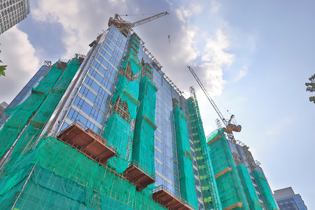 a Exterior of the apartment building under construction.