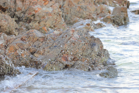 the Sea surface, rocks on the beach