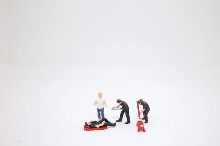 the mini Worker of a car repair 版權商用圖片