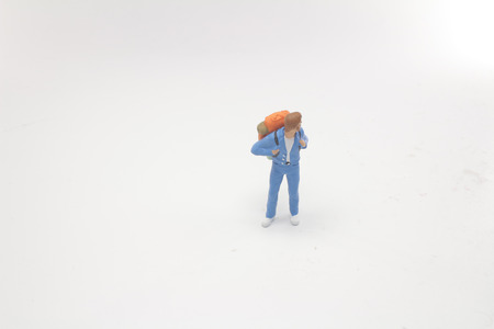 Traveler mini people with backpack stand 写真素材