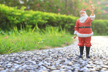 a Santa Claus figures on nature background