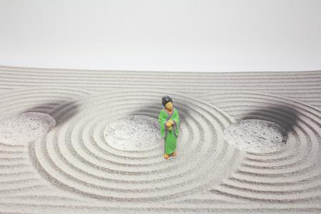 figurine of japanese stand on stone garden