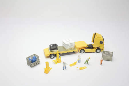 the  figurine of worker with a lorry