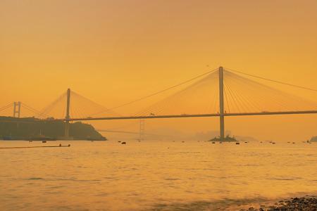 a Hong Kong sunset with suspension bridge