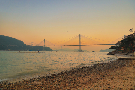 a Hong Kong sunset with suspension bridge