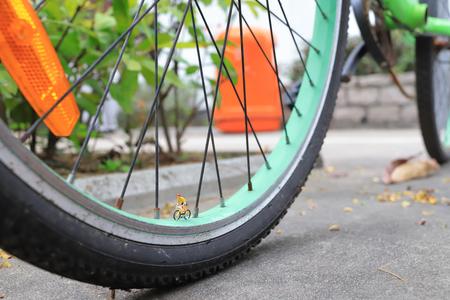 the figure ride the bike on bike