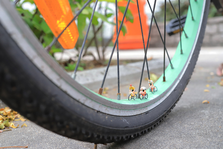 the tiny of figure ride the bike on bike