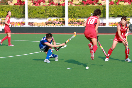 a woman field hockey match at asia game Editorial