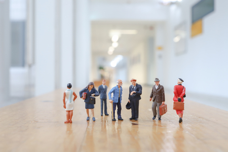 a Crowd of mini figures in conference hall