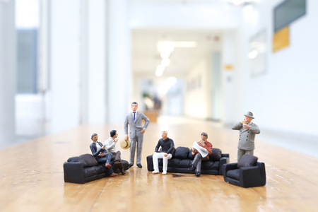 the mini of figure people closing deal in office