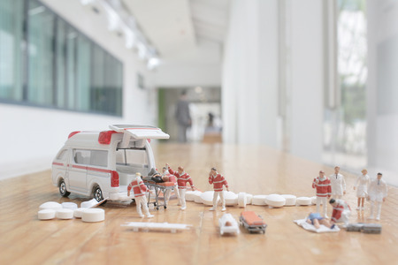mini figures of first aid and ambulance Stock Photo