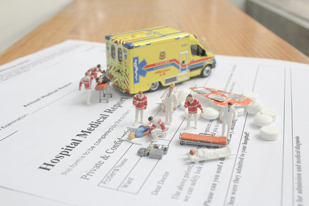 mini figures with hospital medical report