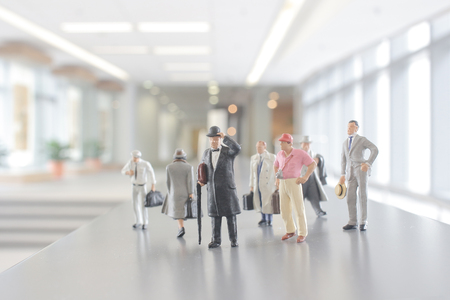 mini figure people walking in the office corridor.